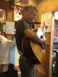 Yakitori guitar player
